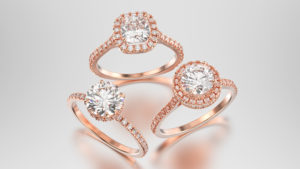 Three rose gold rings with diamonds