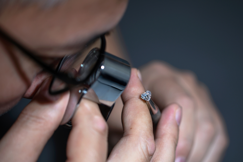 Jeweler Using a Loupe to look at a diamond