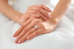 Young bride showing off her beautiful engagement ring